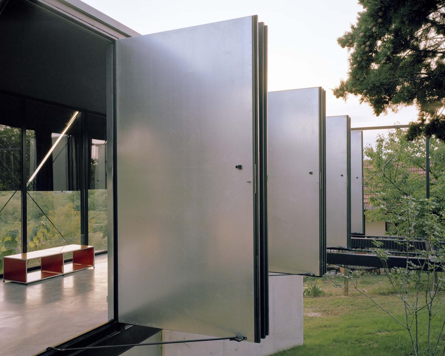 Metal shutters, House for a Craftsman, TEN Architects
