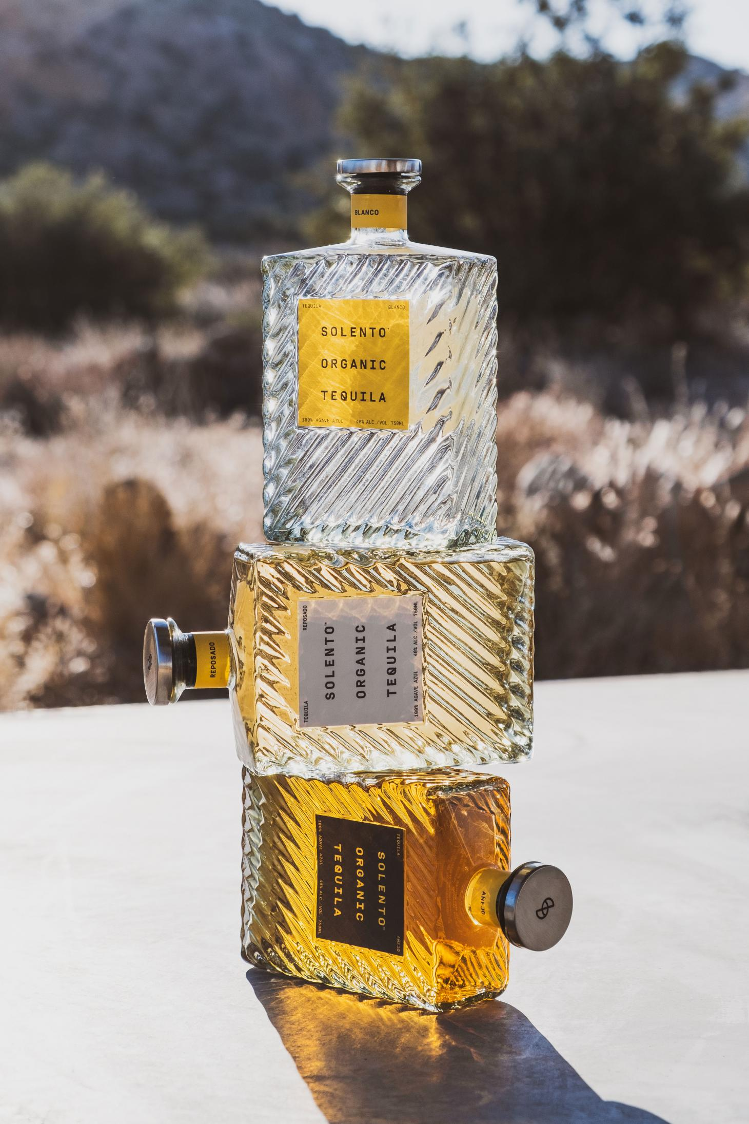 Solento tequila glass bottles stacked on top of one another