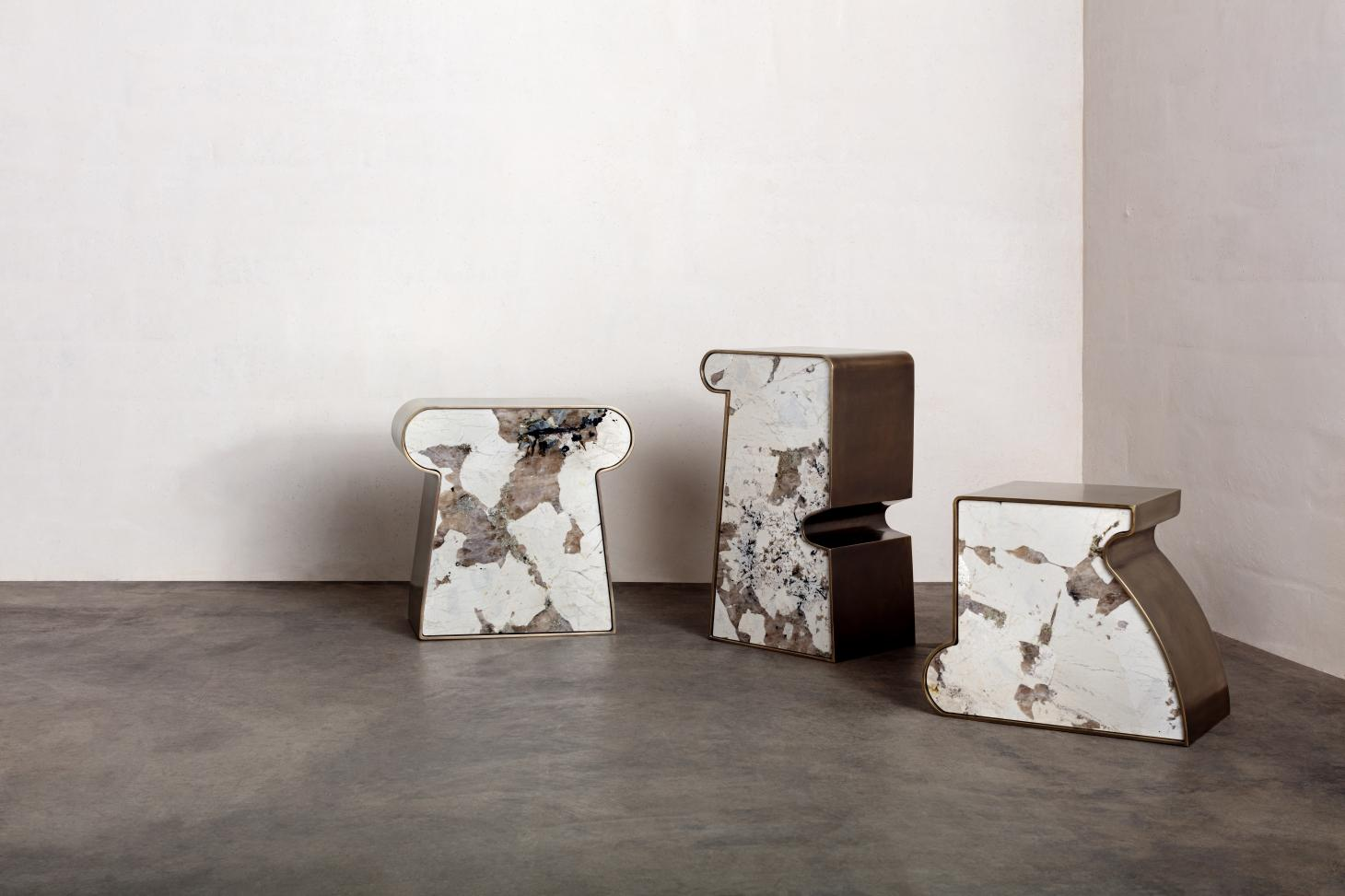 Triad side tables by Kelly Wearstler, characterized by monolithic forms in marble and brass