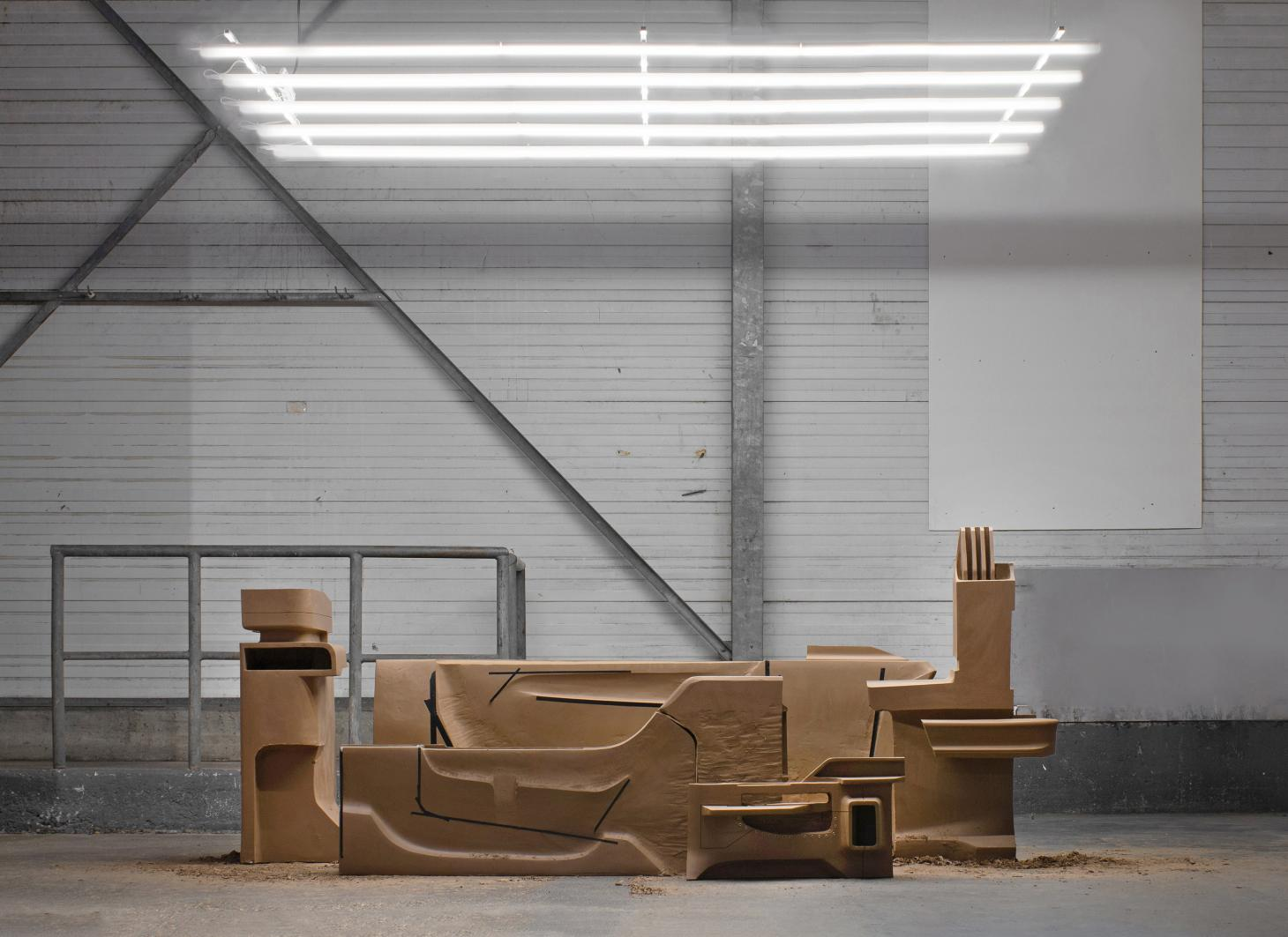 Installation of clay structures in warehouse-style space by Johanna Seelemann