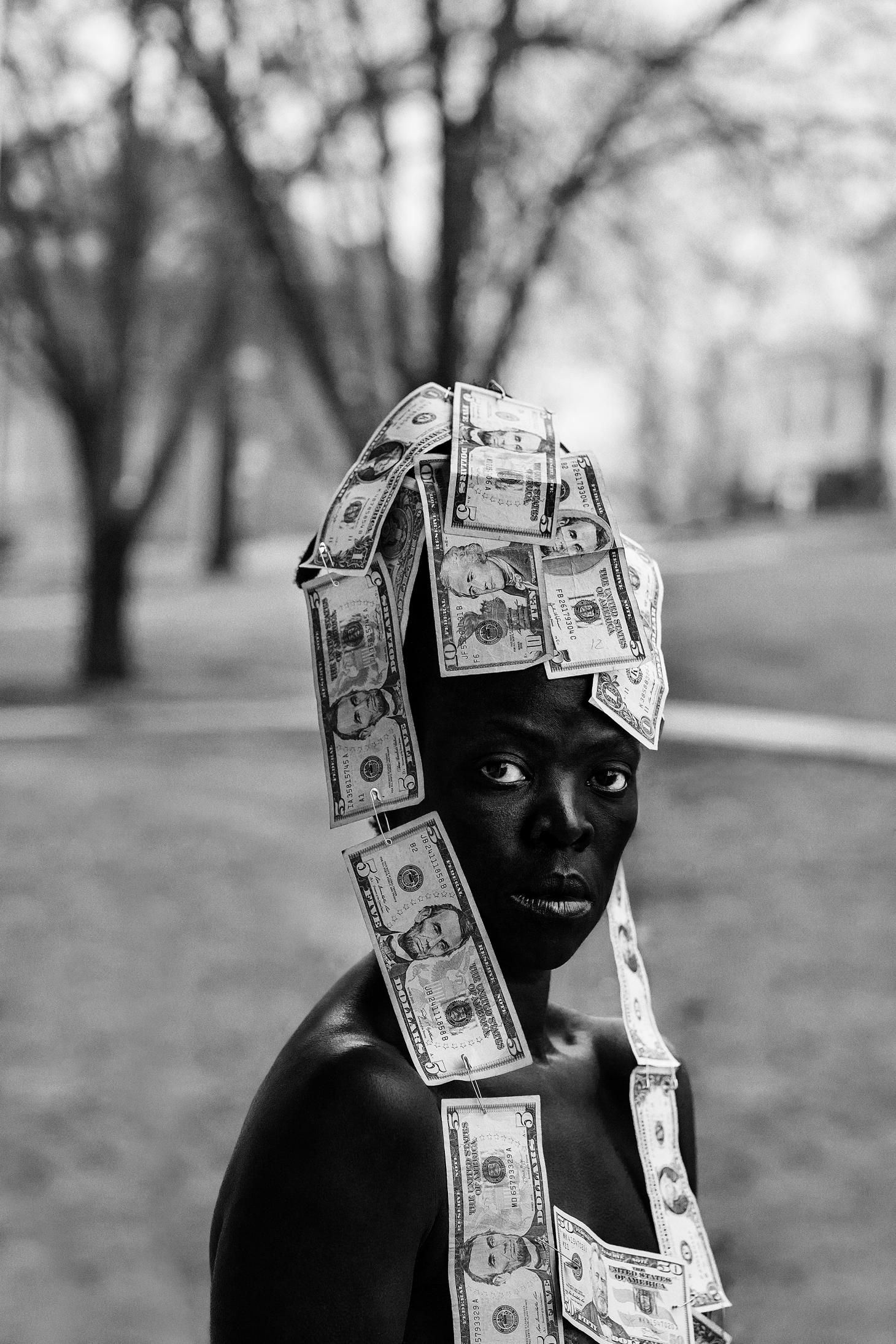 Photograph of a person with a headpiece made out of dollar bills by photographer Zanele Muholi, on display at Photo 2021 Melbourne.