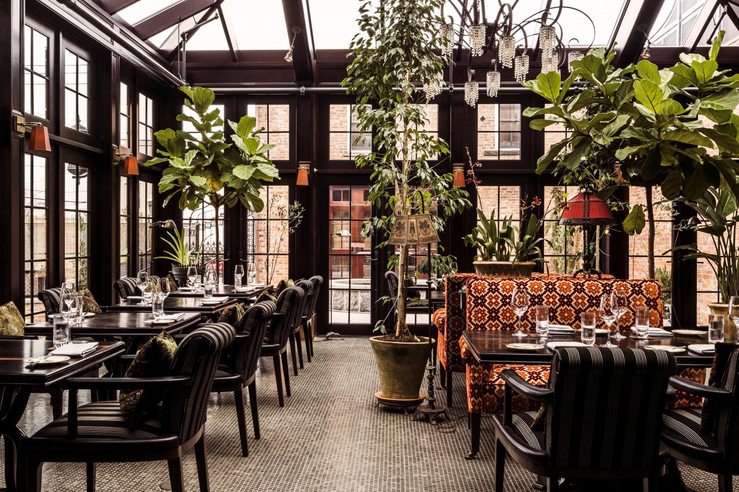 The conservatory dining room at The Maker hotel in Hudson, New York