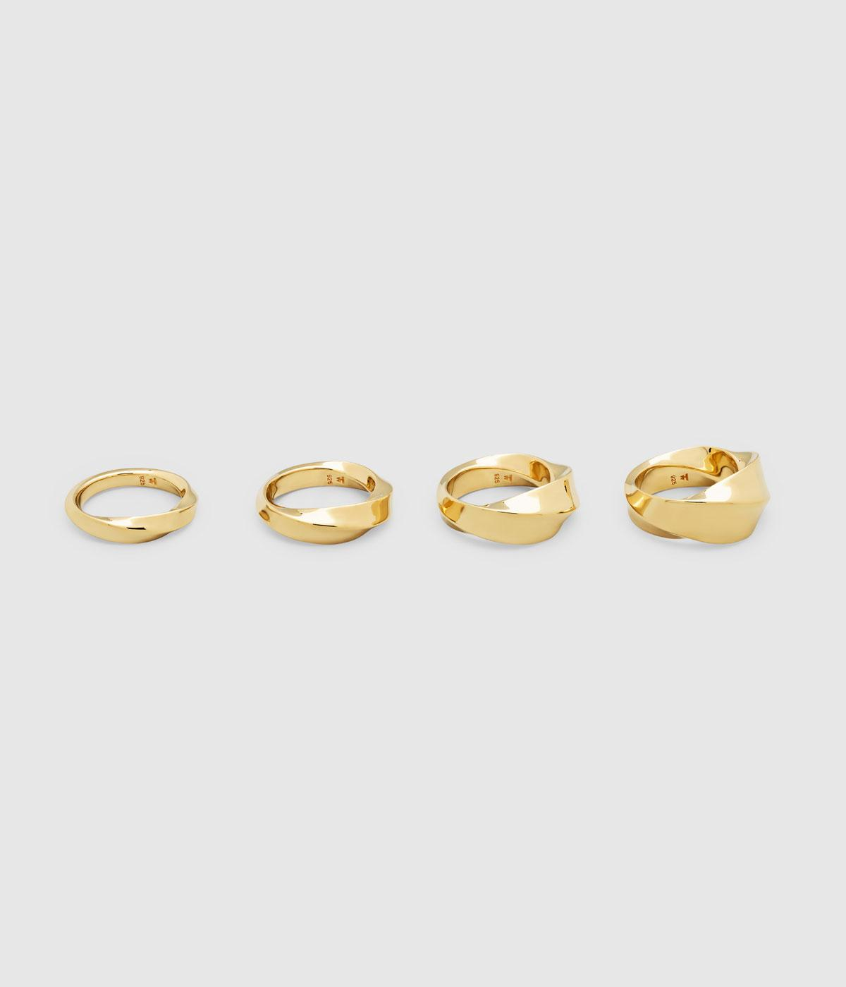 Line of gold rings against a grey background