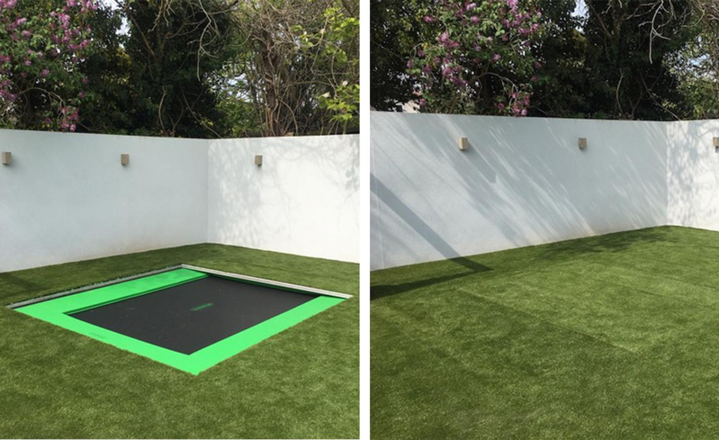 Trampoline in ground with grass half covering it