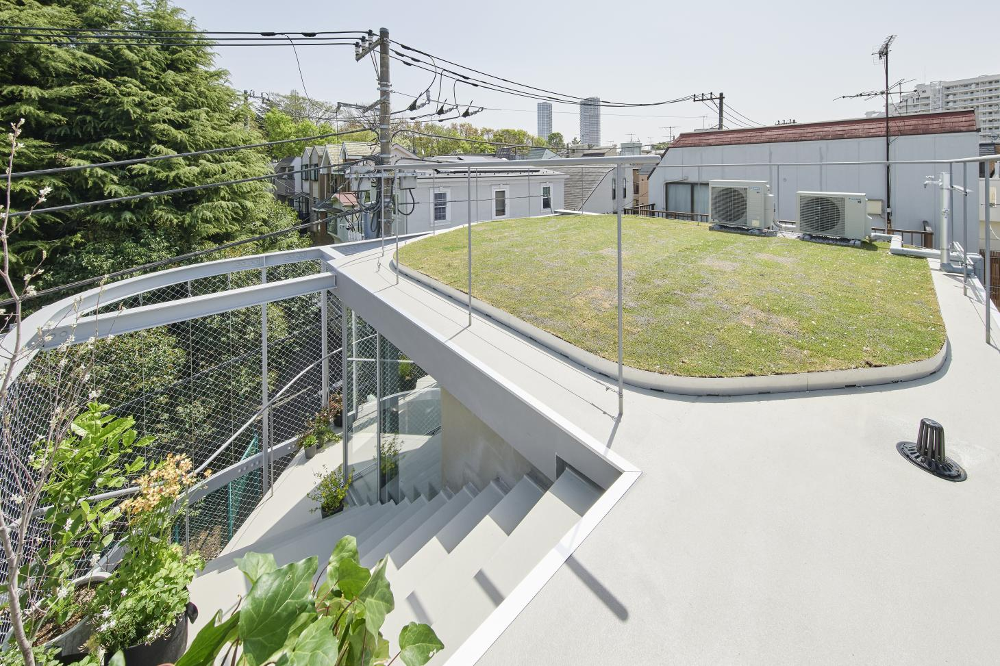 view from above at quirky Tokyo house that blends domestic and urban park