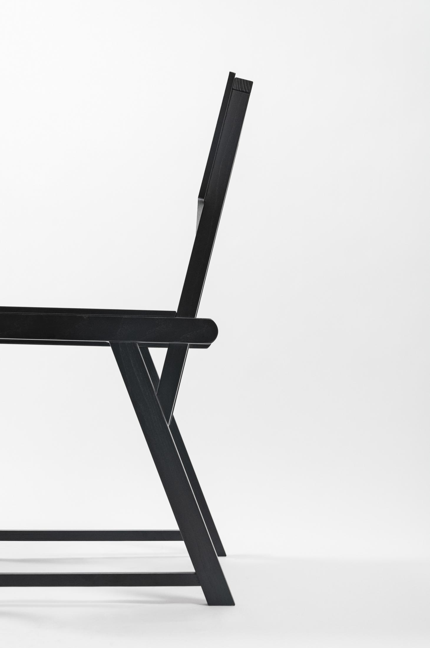 Side view of black wooden chair