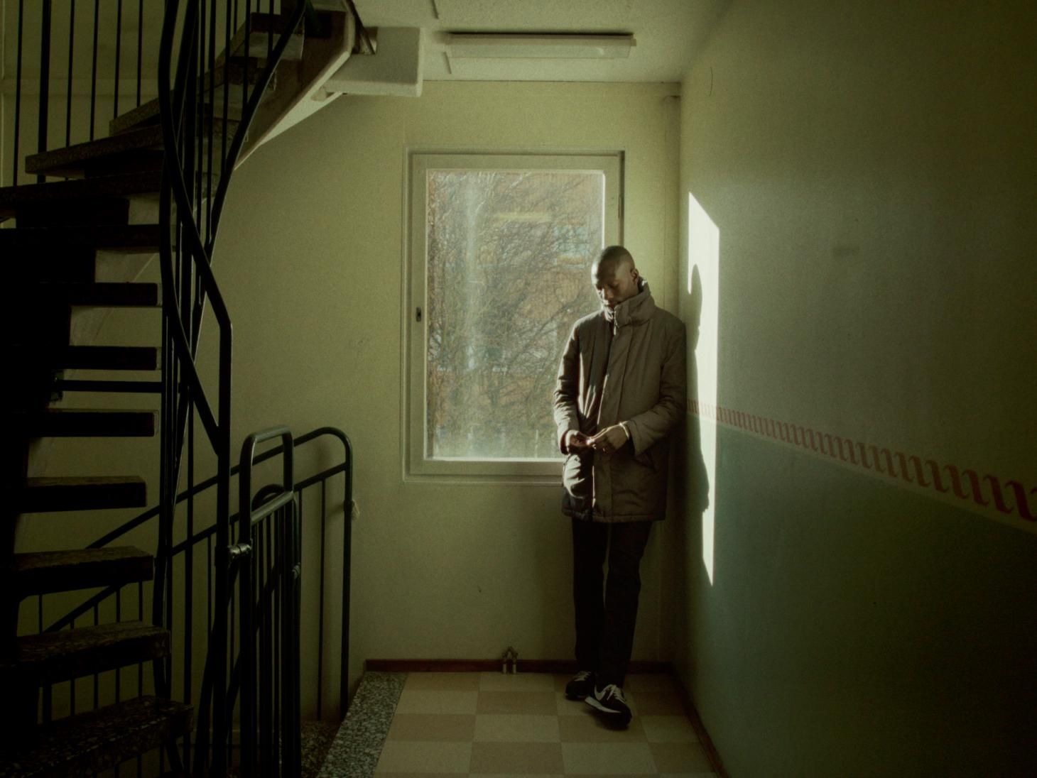 man in a stairwell in a swedish high rise building