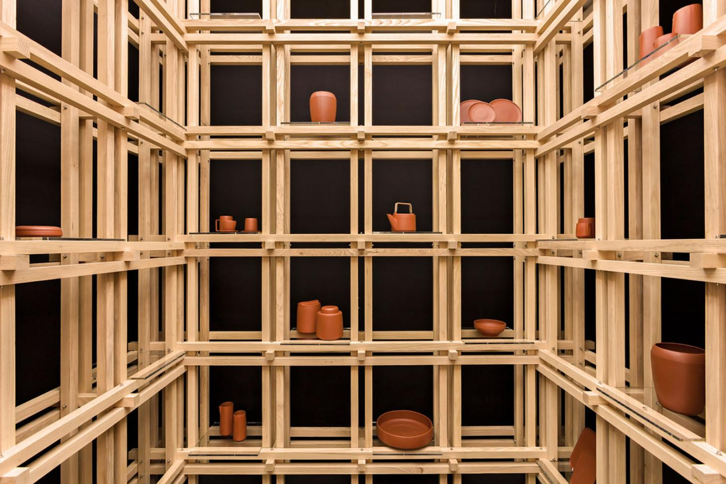A wooden shelf structure holding ceramics