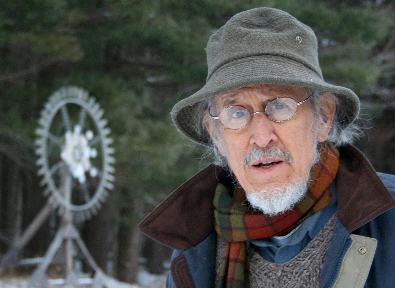 Portrait of American kinetic artist Tim Prentice with sculpture