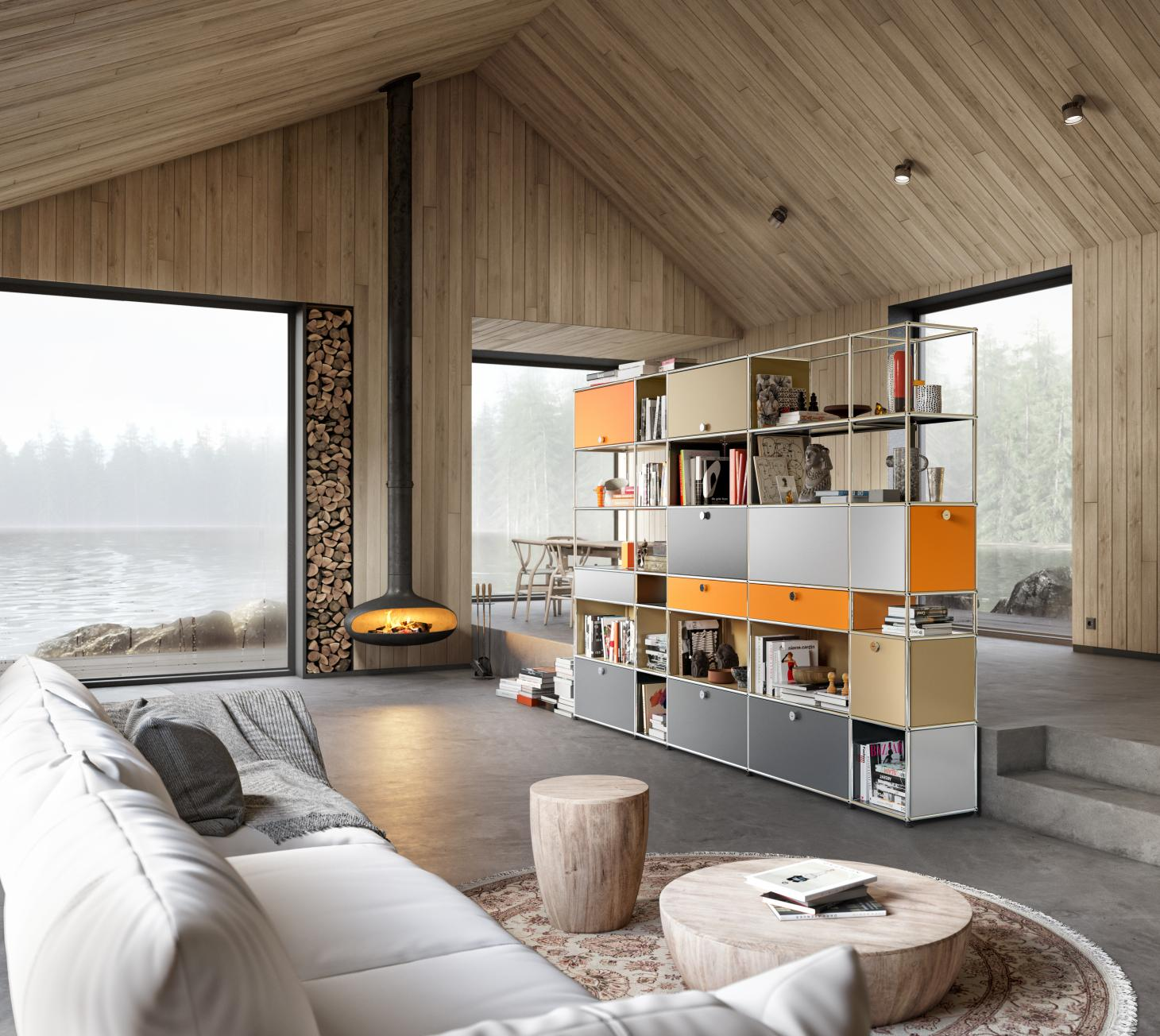 Wood clad room with large windows overlooking the sea, fireplace and USM Haller storage