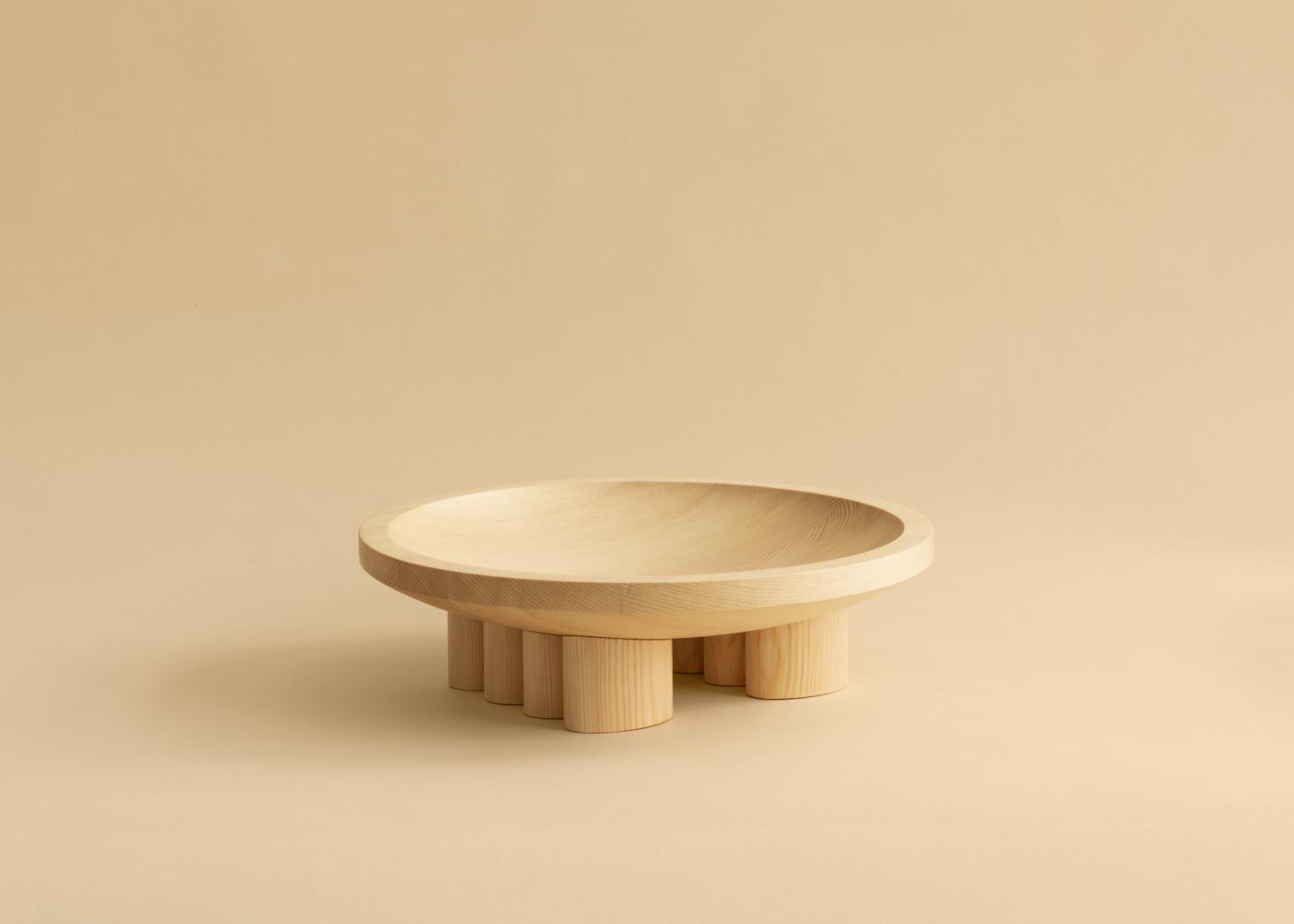 Vaarnii wooden bowl by Mac Collins on pale background