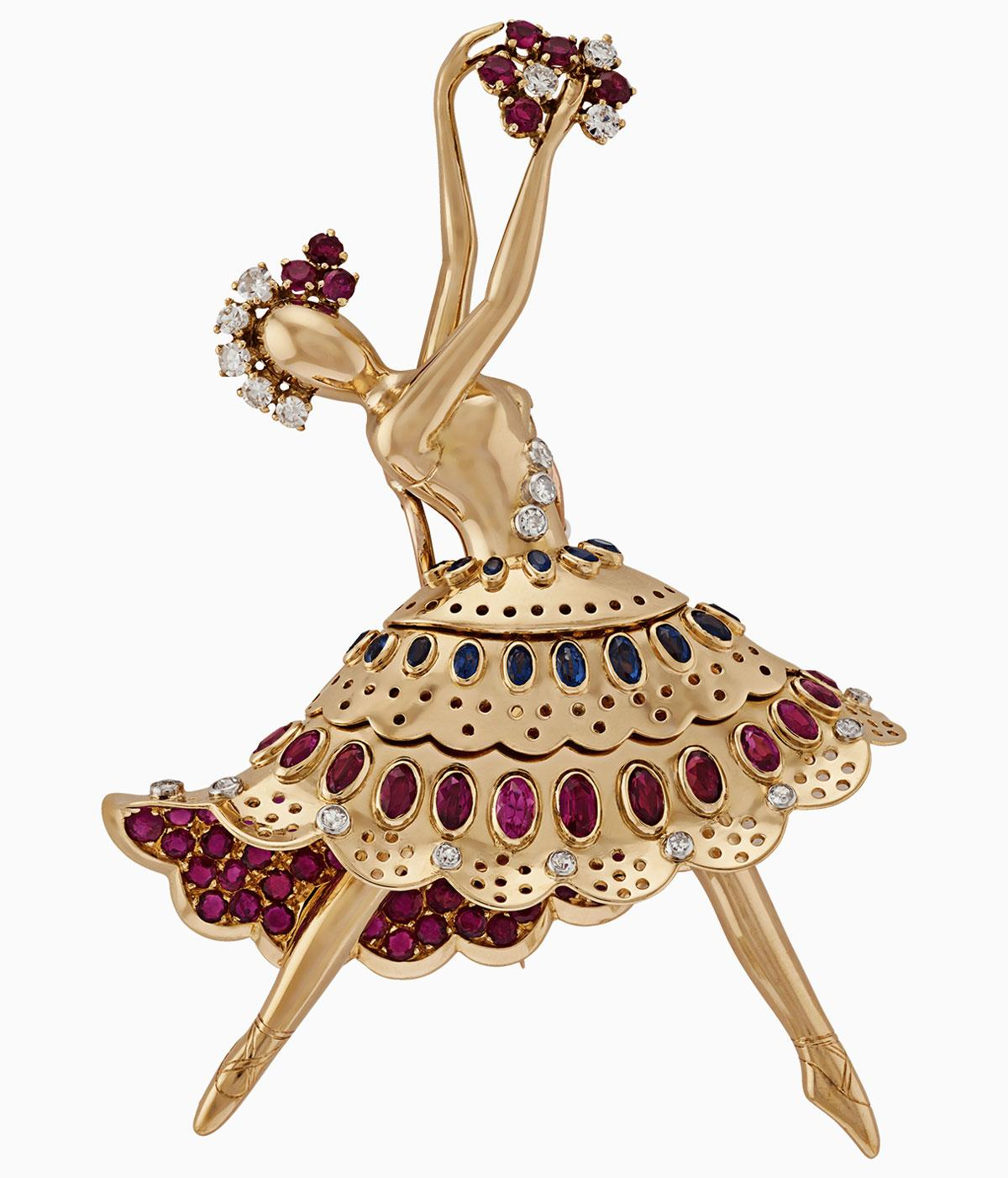 Ballerina in gold with colourful stones on her skirt