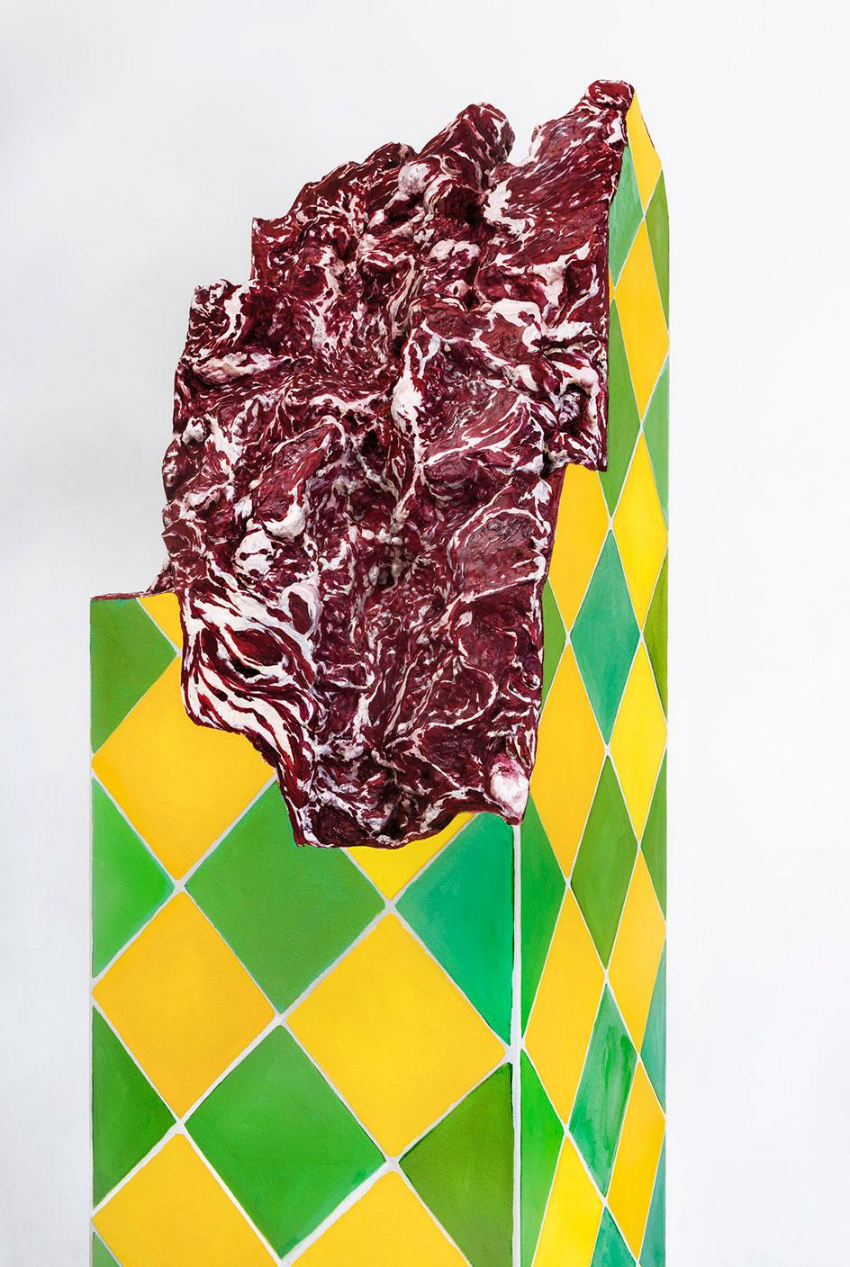 Adriana Varejão,Ruína Brasilis [Brasilis Ruin], 2021.Oil on canvas and polyurethane with aluminum support a sculpture in the colours of the Brazilian flag with meat protruding from within