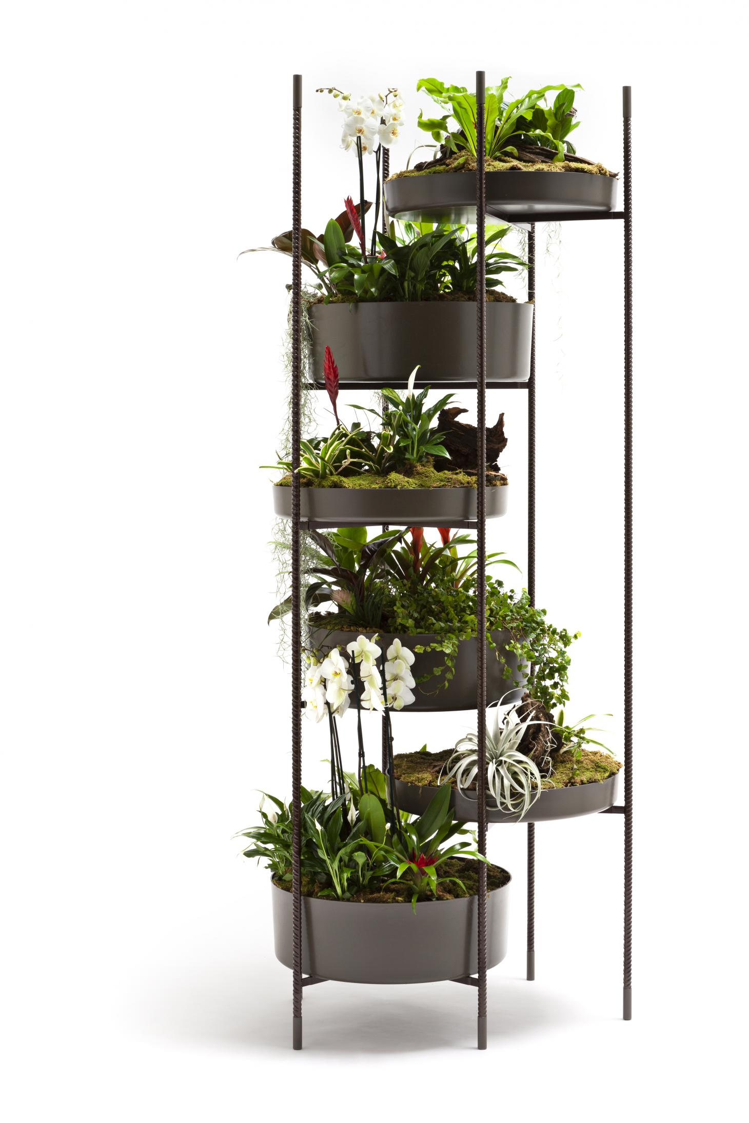 A black powder coated aluminium planter shaped like a tower with several trays for plants. Shown with green foliage throughout