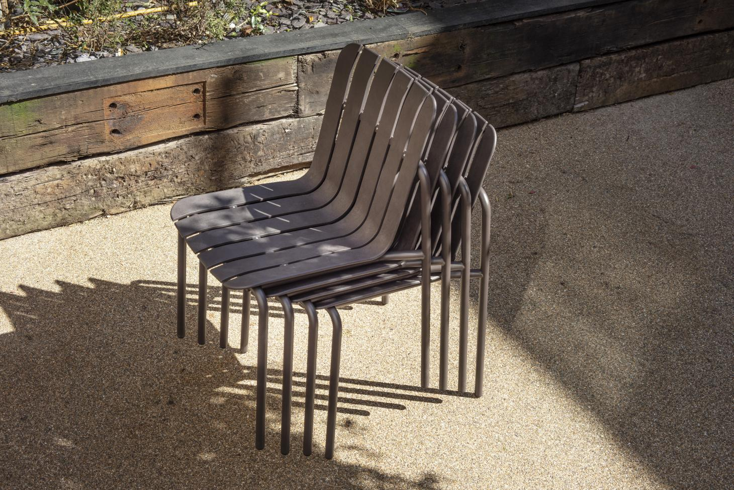Stack of recycled outdoor chairs by Very Good & Proper