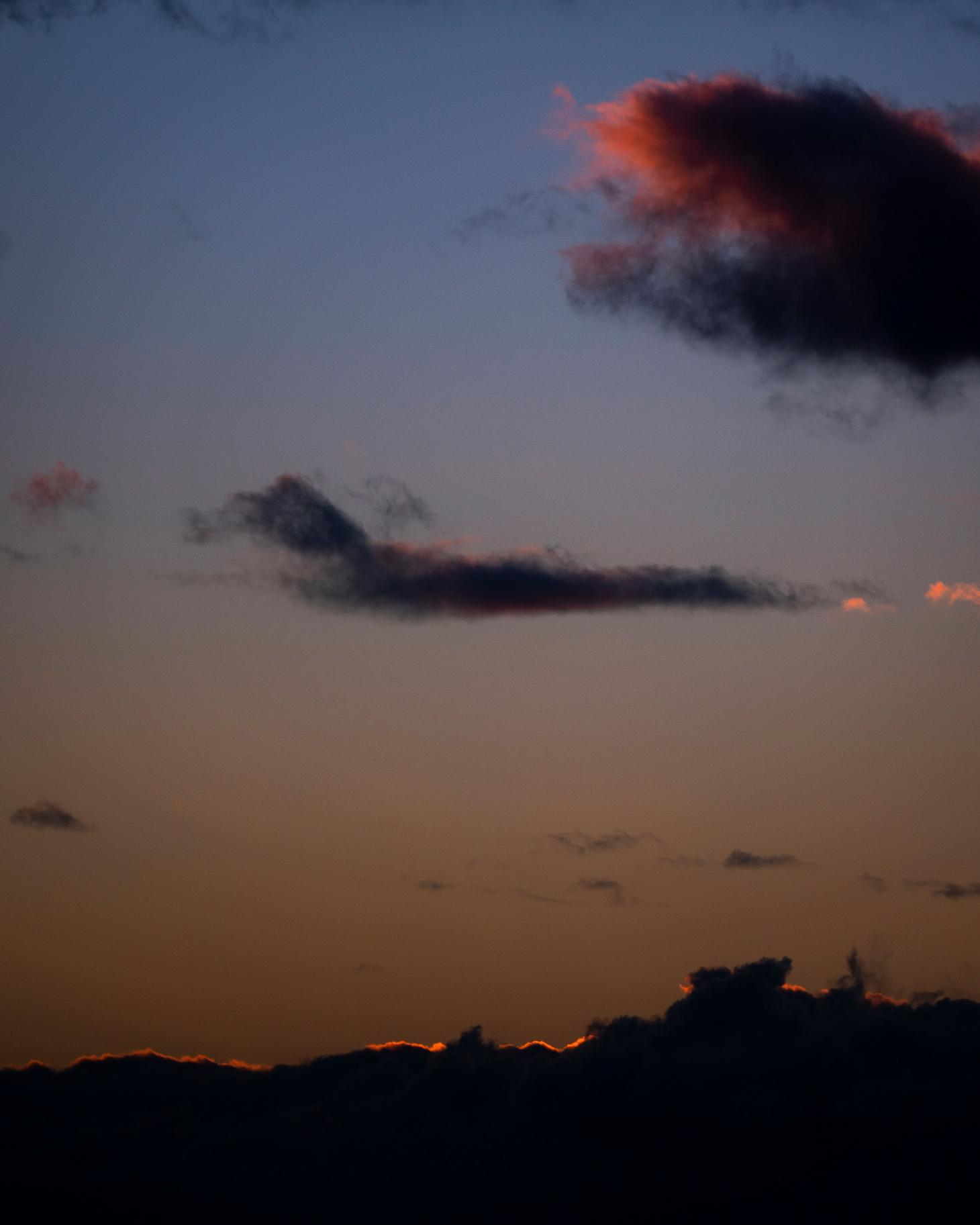 Photographby Igor Pjoort fromVyrao'sWitchy Woo campaignshowing purple sunset and dark mountains