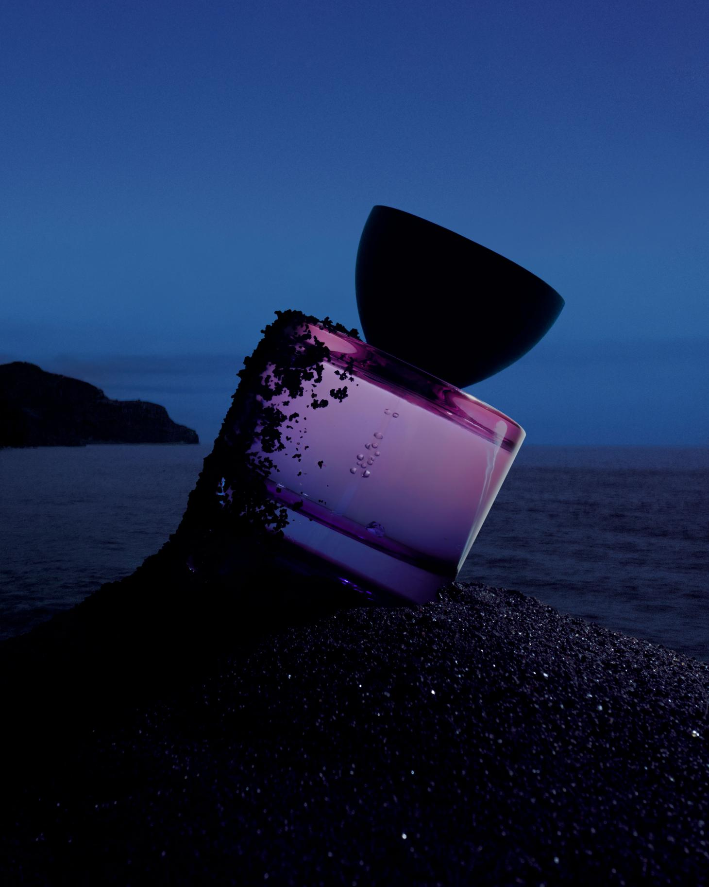 Photographby Igor Pjoort fromVyrao'sWitchy Woo campaignshowing purple bottle in black sand
