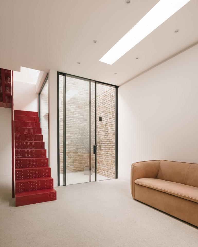 red staircase in East London house
