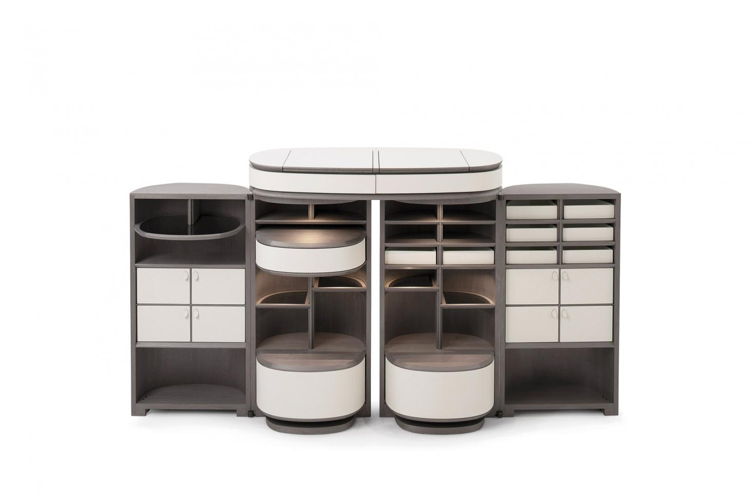 A large drinks cabinet with four compartments, each featuring shelves and drawings, in grey and white