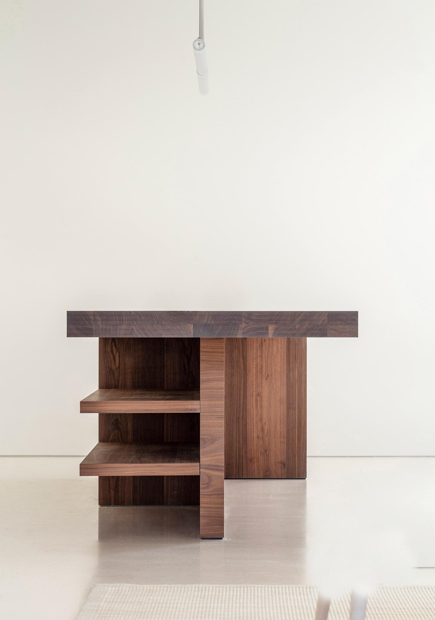 The side of a wooden kitchen designed by John Pawson for Obumex featuring side shelves