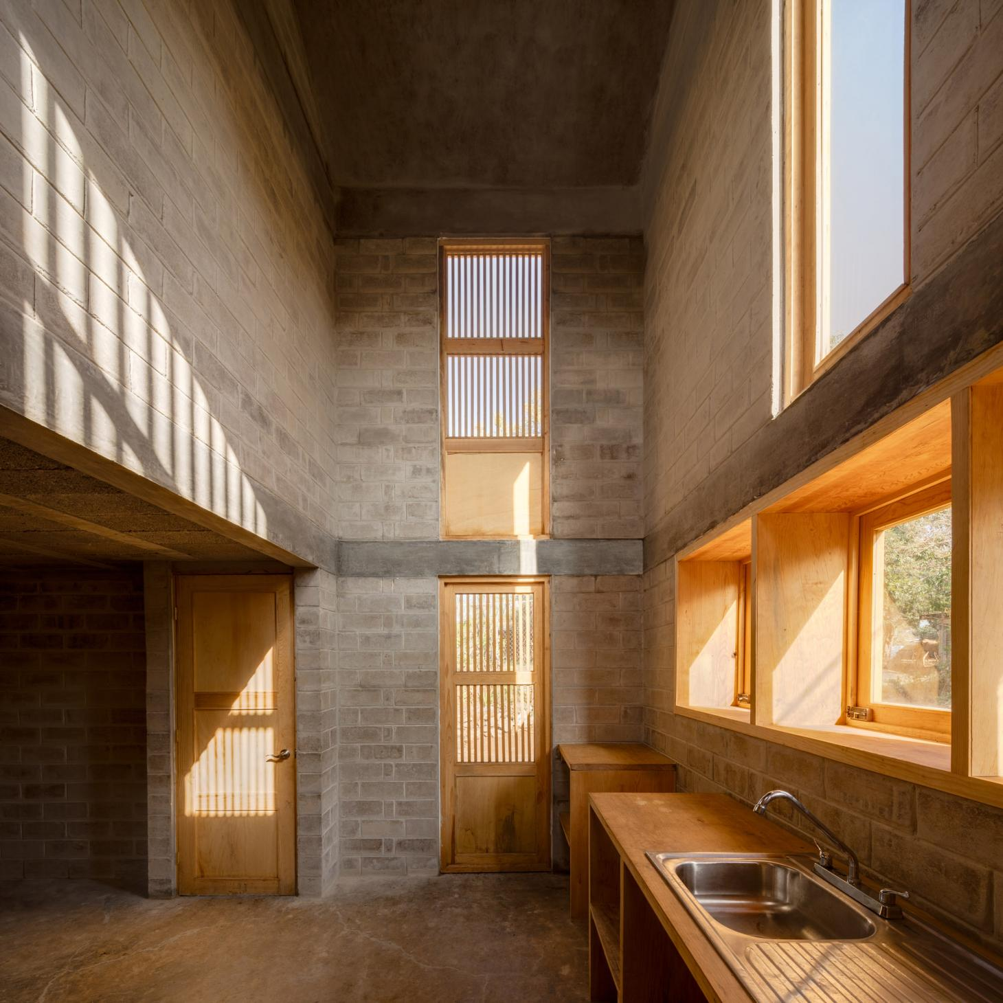 the bare interior of Casa Eva, a low cost housing designed by Fernanda Canales