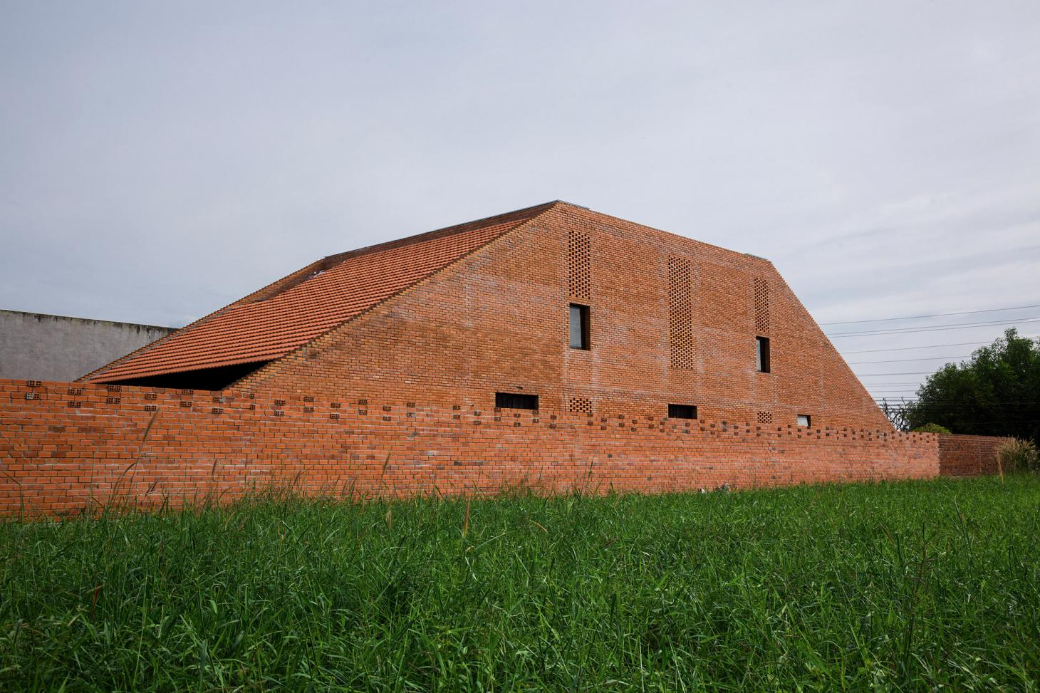 the brick form of a house designed by Tropical Space in Vietnam