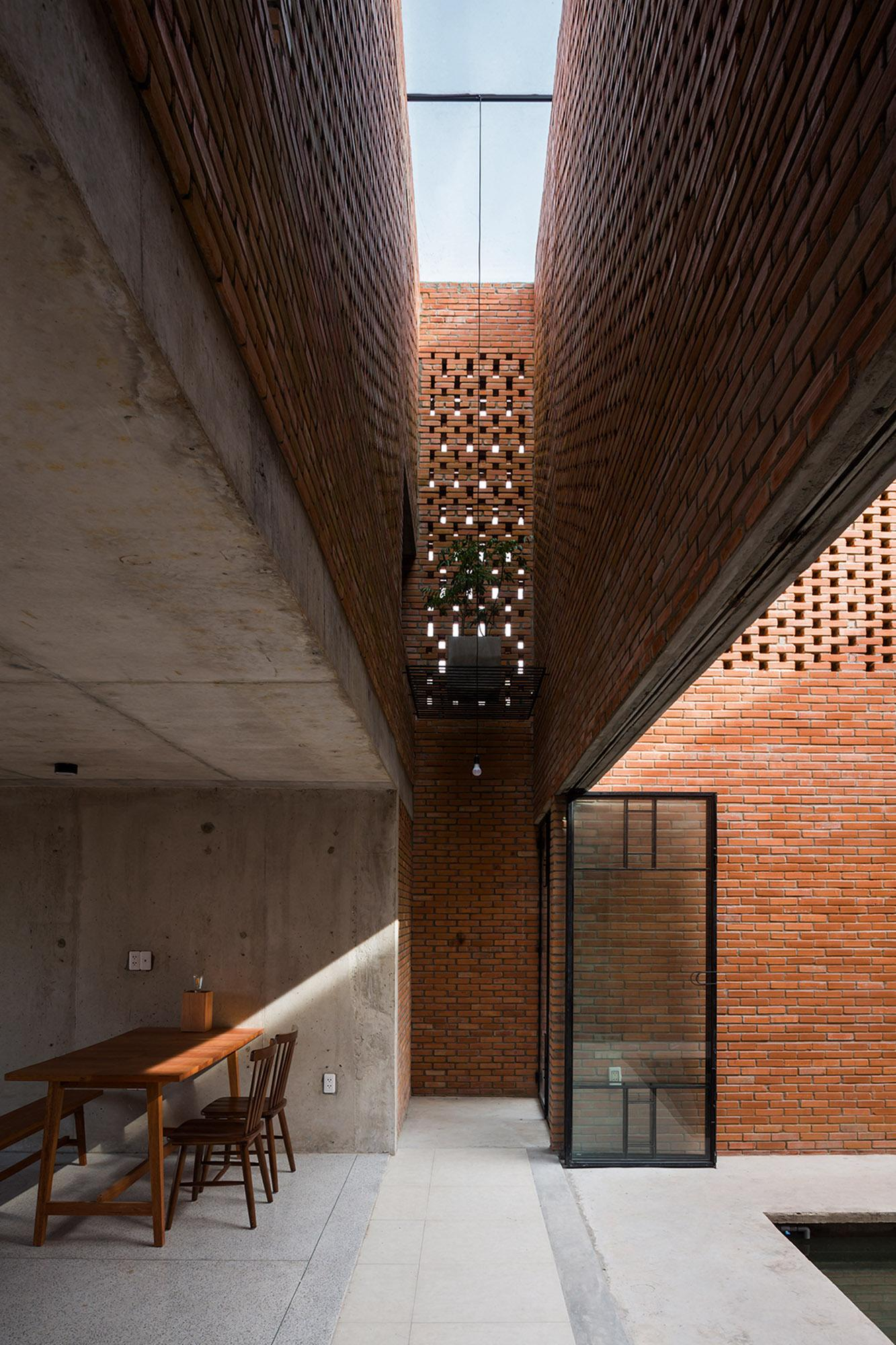 open interior of Vietnam brick house by tropical space