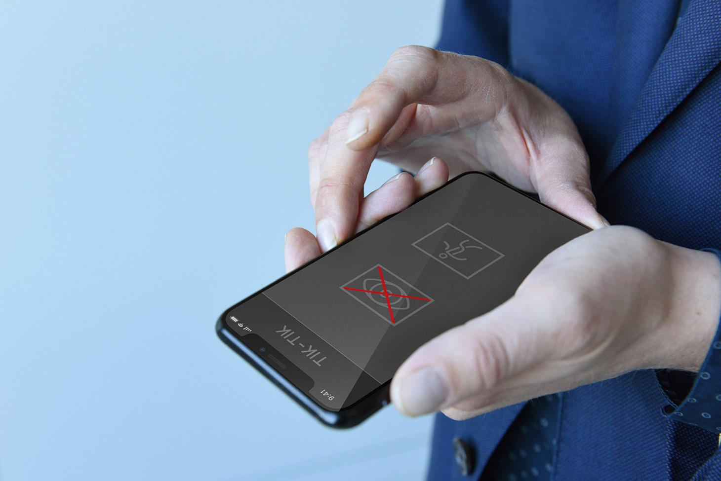 Two hands holding a phone with the interface for Tik Tik by Simon Dogger