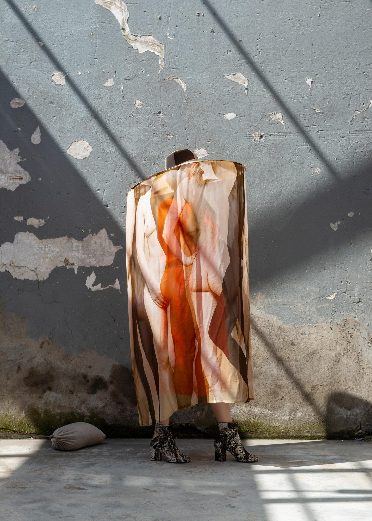 Cape by Buro Belen with print featuring human body