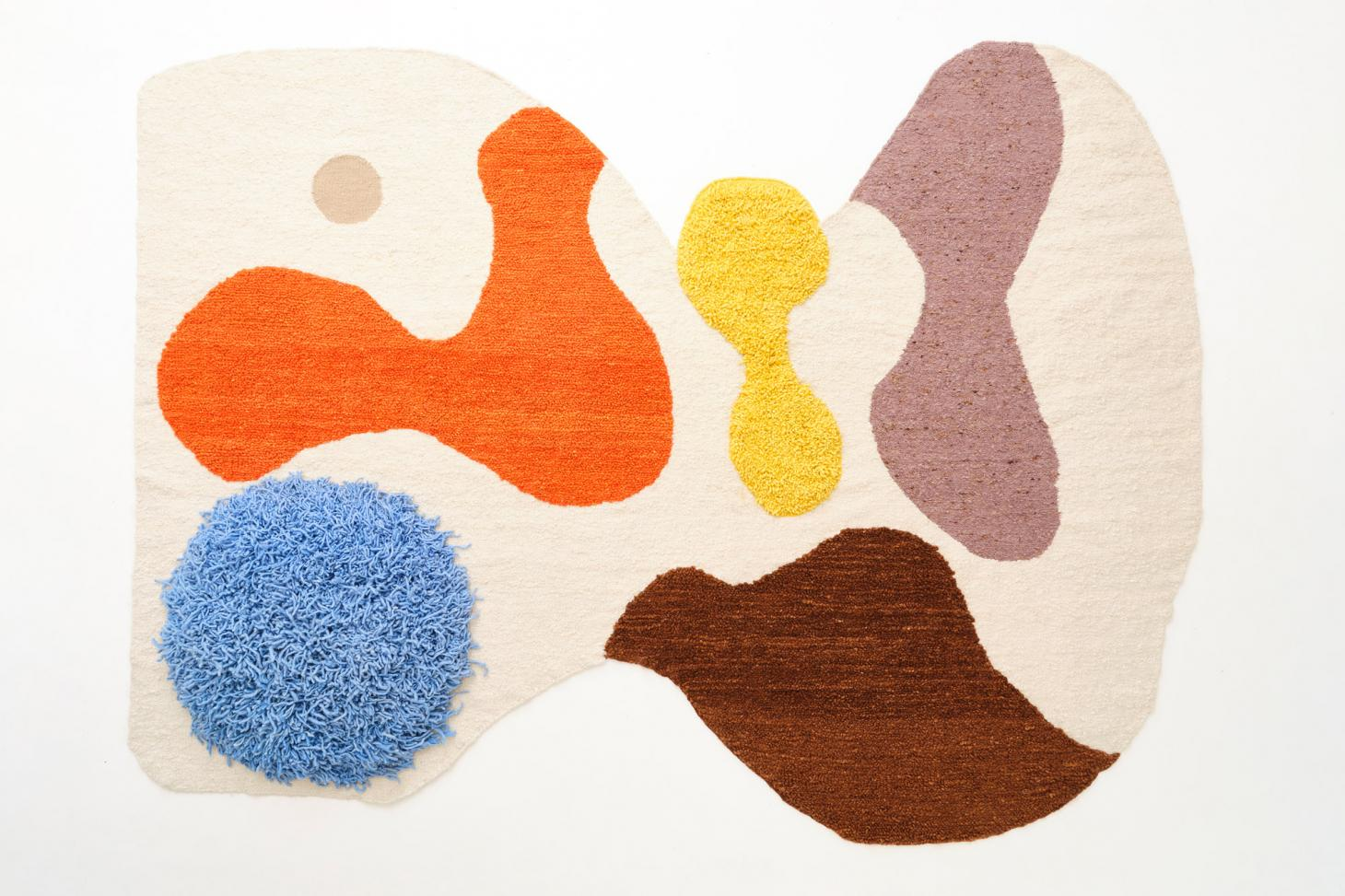 White rug with colourful abstract shapes