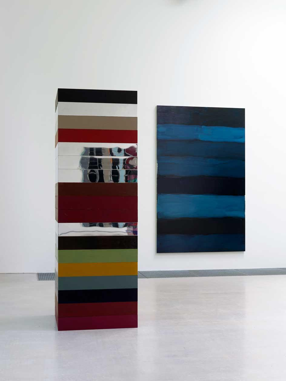 Installation view of Sean Scully's exhibition at Waldfrieden Sculpture Park in Germany in which the artist's stacks are in conversation with his paintings