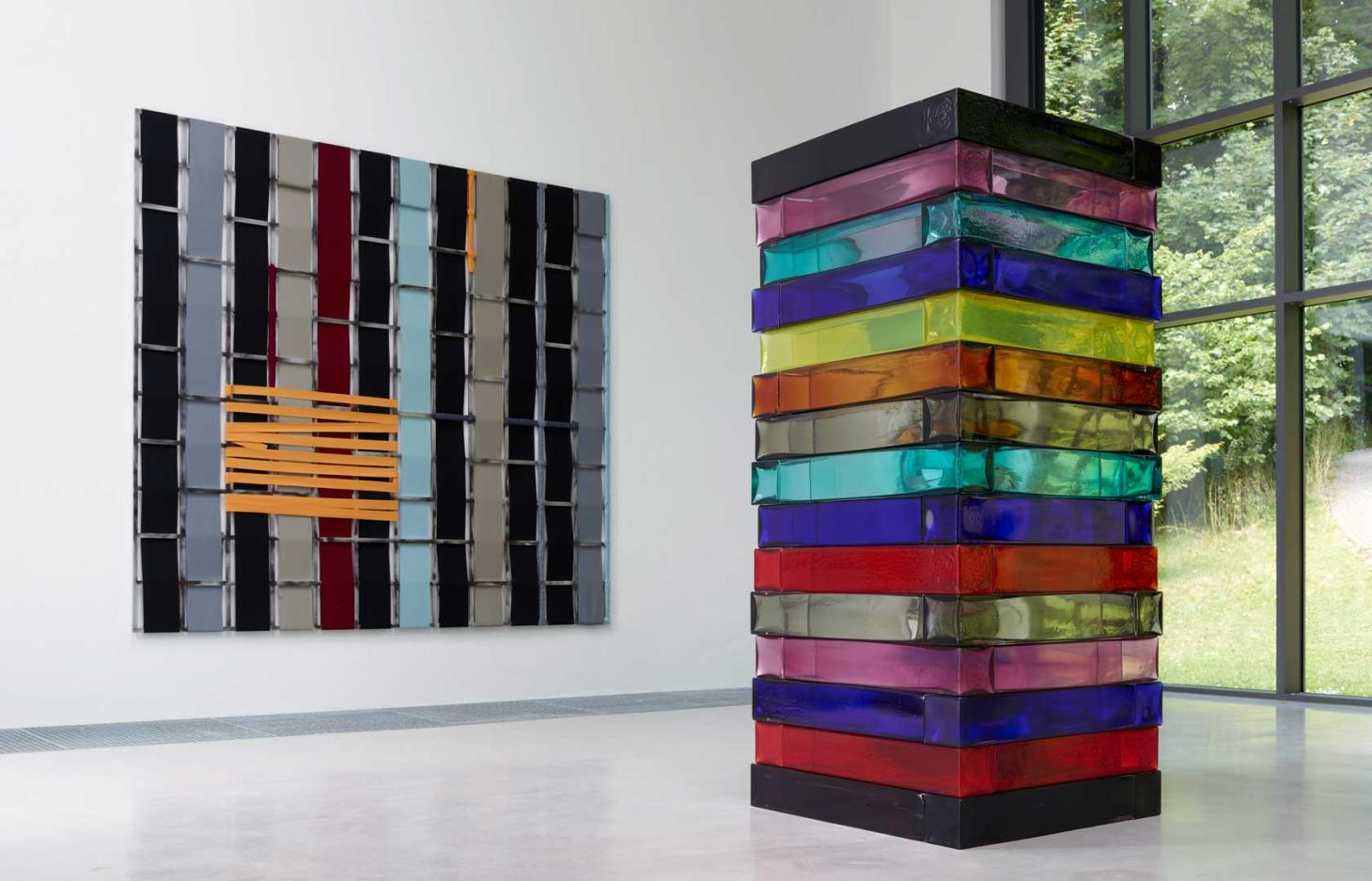 Installation view of Sean Scully's exhibition at Waldfrieden Sculpture Park in Germany featuring his glass piece Stack