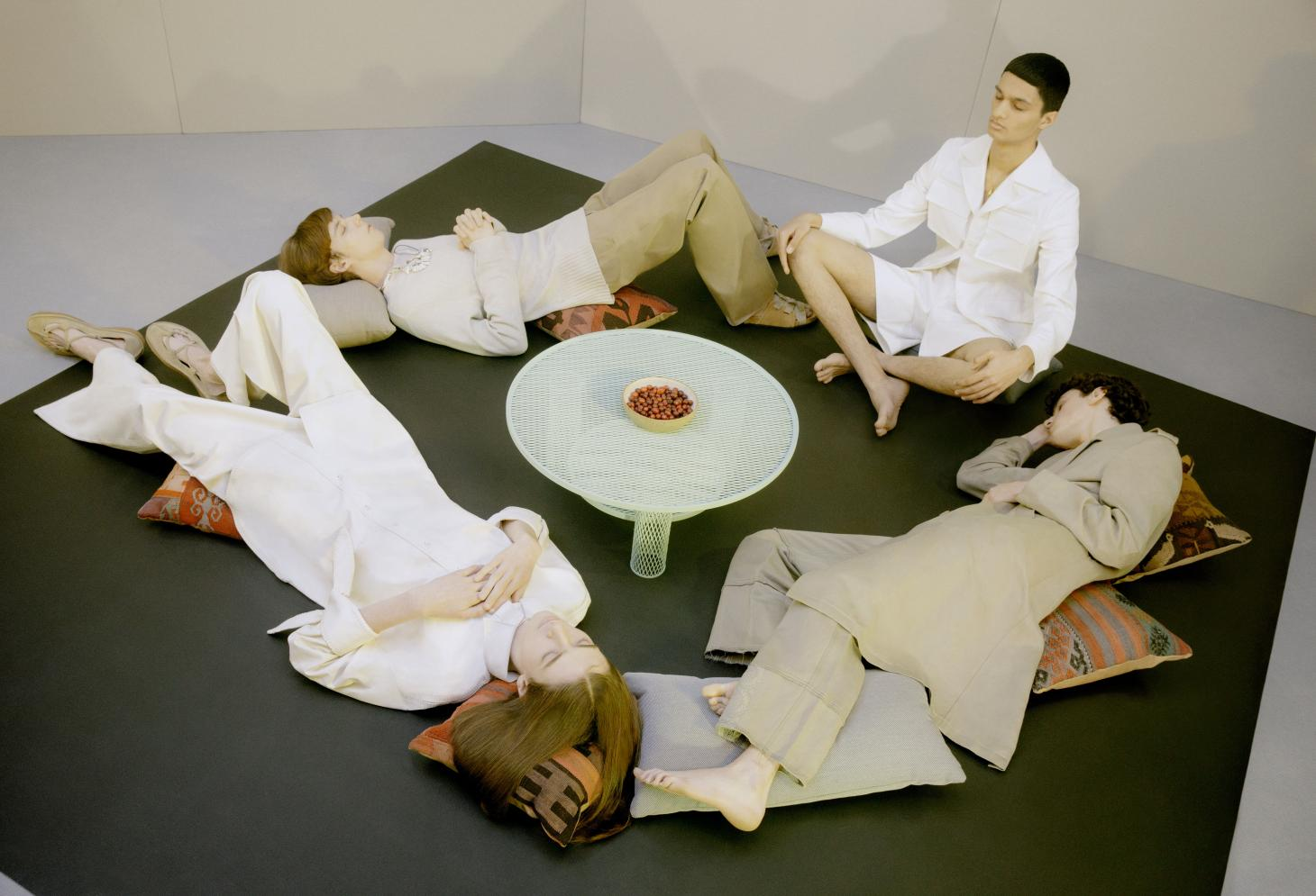 a group of men lying down in a circle