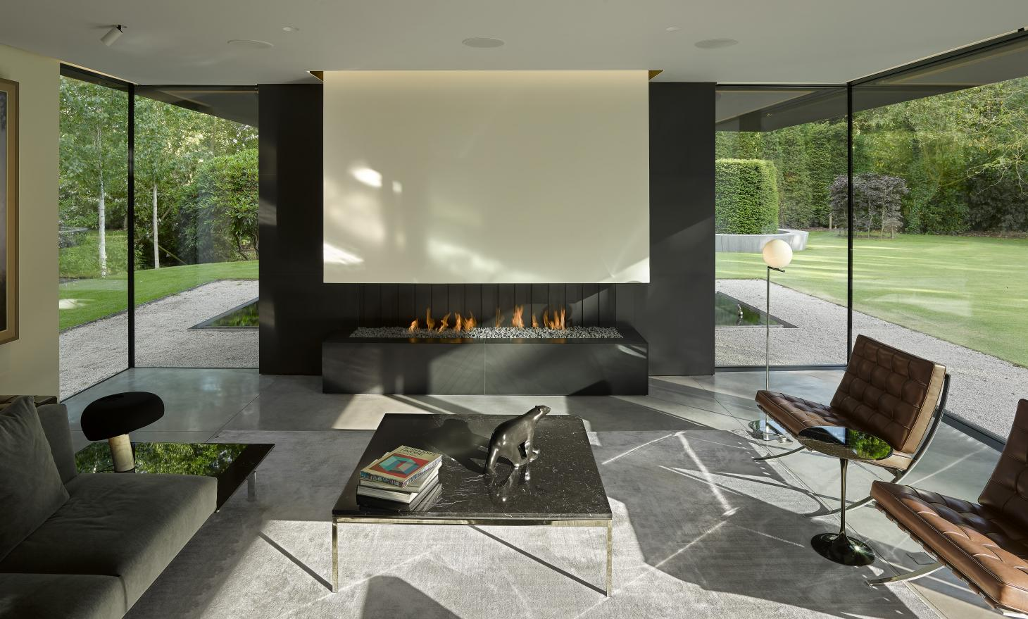 Winter House's impressive main formal living space enclosed in glass
