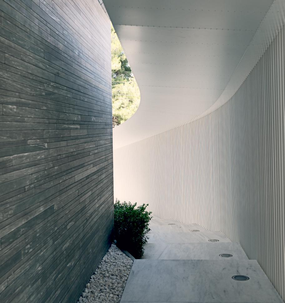Sheltered marble steps at Psychiko House, Athens, by Divercity
