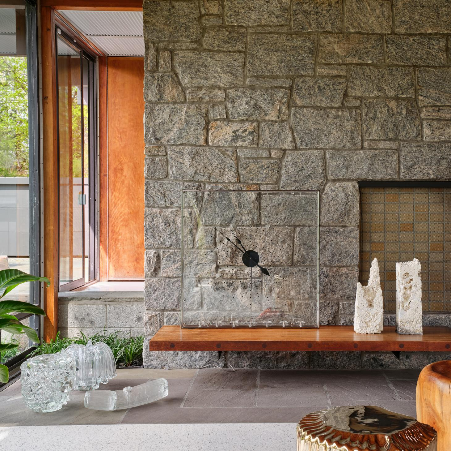 Living room interior with terrazzo floor and stone wall in house by Gerald Luss