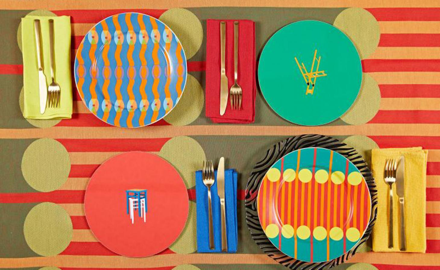 Colourful plates and cutlery on a colourful mat