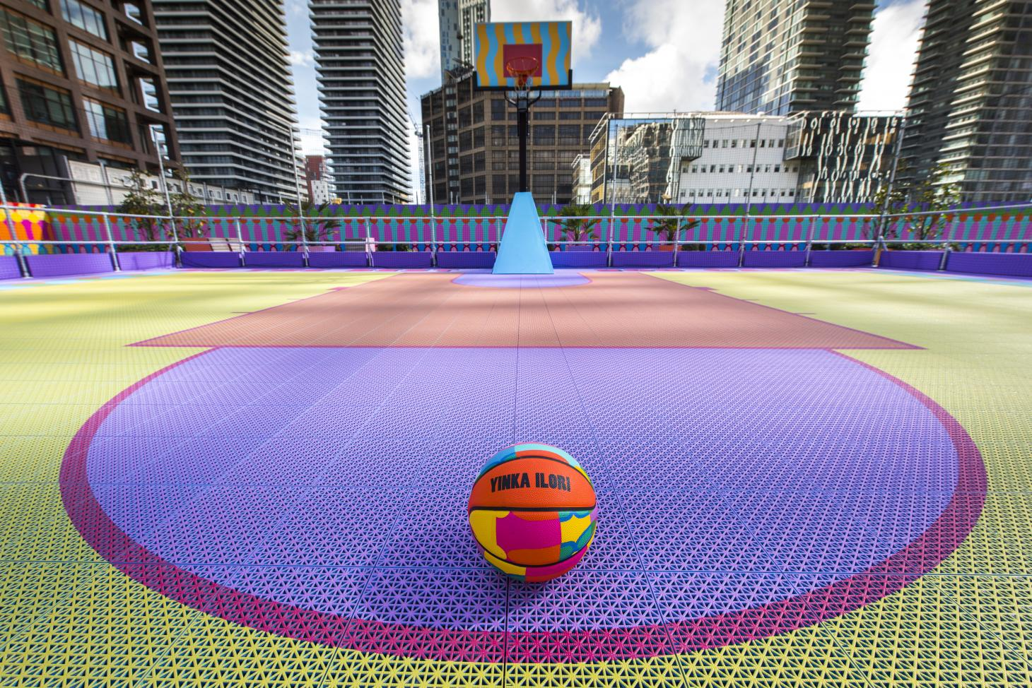 The basketball court designed by Yinka Ilori for the Canary Wharf Estate. For the project, Ilori also designed a limited-edition ball