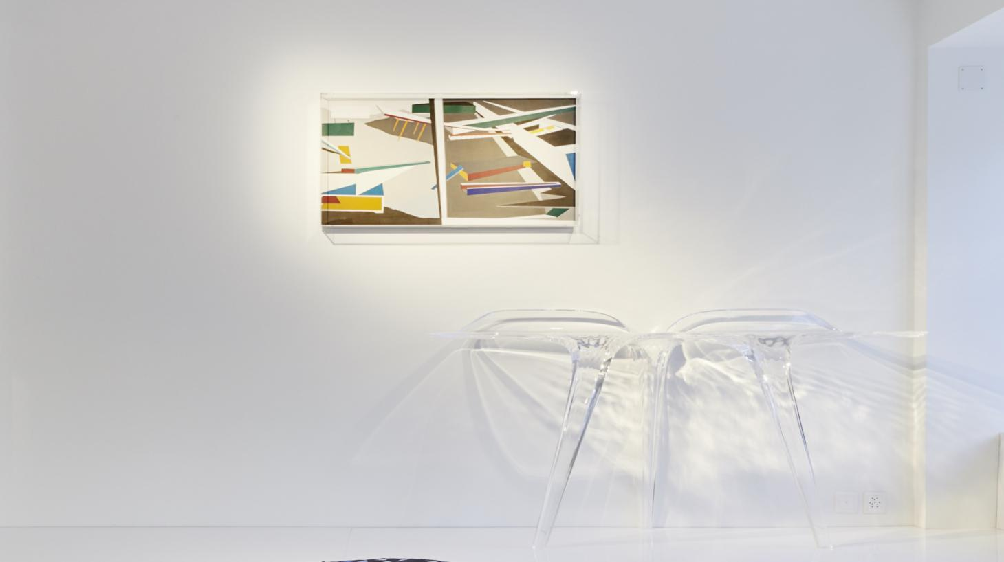 Clear acrylic table by Zaha Hadid and painting on wall