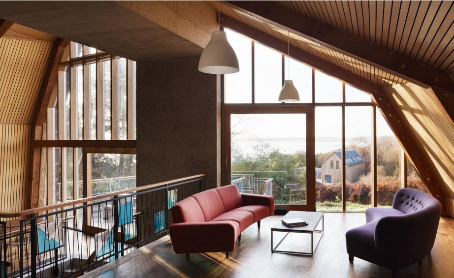 The Main Living Space Of Houseboat Is Dominated By A Triple Height Concrete Arch An Upper Level Snug Benefits From Internal Views As Well Outlook