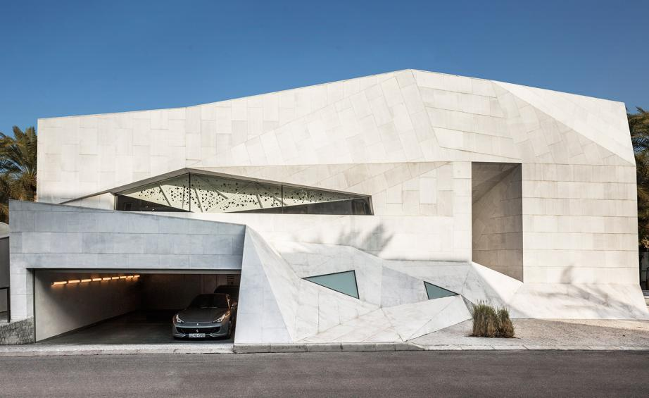 With the appearence of a sheet of paper that has been bent and folded, the  1300 sq m Origami House is formed from reinforced concrete, with recessed  ...