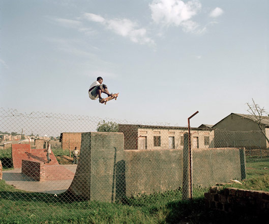 skateboarder in flight photo Yann Gross