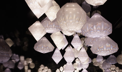'Amplify' by Yves Béhar, featuring a series of folded paper, Swarovski crystal-filled lanterns.