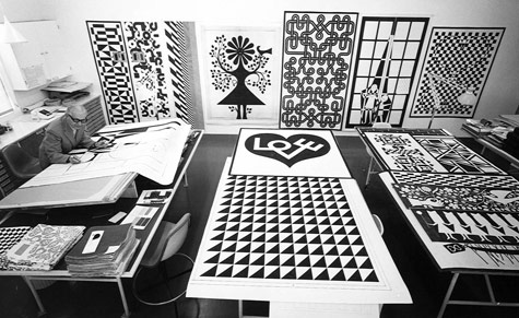 Alexander Girard, famed textile designer and Herman Miller collaborator, at work in his studio, circa 1972. Photograph from the Herman Miller archive